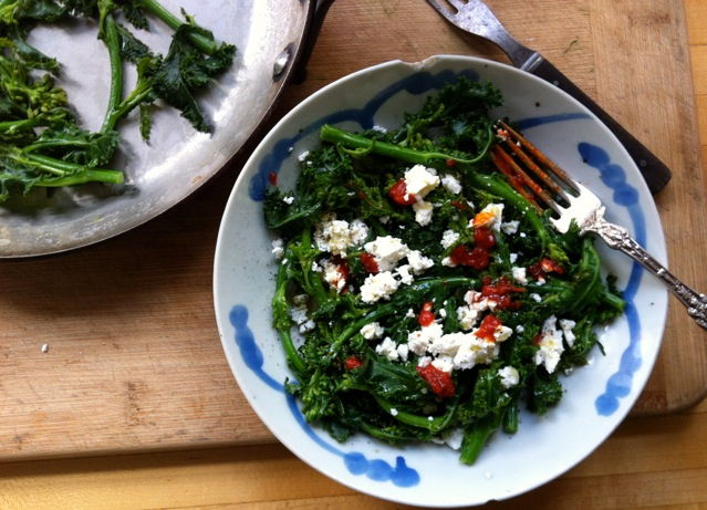 steamed raab with harissa and feta