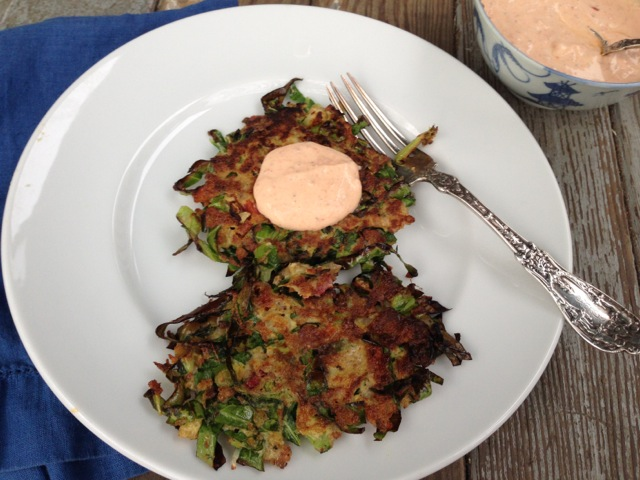collard fritters plated yogurt sauce