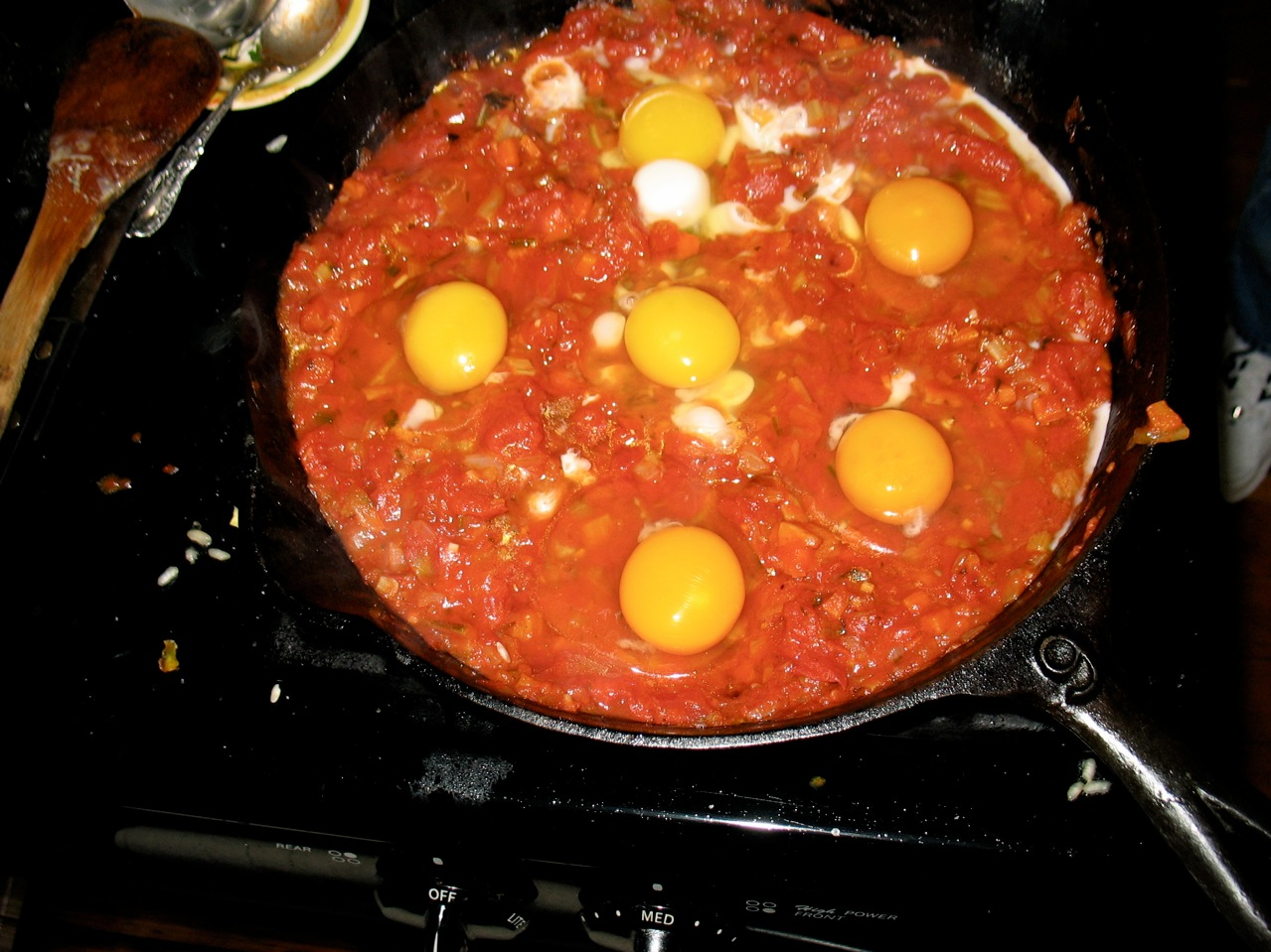 This is a standard Italian dish. If you have pre-made tomato sauce it takes mere minutes and if you have fresh tomatoes it doesn't take much longer to put together a quick sauce. Top the eggs with some grated parmesan towards the end for a fancier dish and be sure to have some good bread on hand to serve with this.