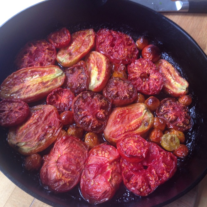 tomatoes roasting in cast iron pan